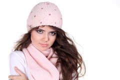 Young Beautiful woman wearing winter clothes, pink Royalty Free Stock Photo