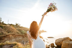 Young beautiful woman in wedding dress on beach Royalty Free Stock Photo