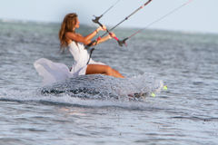 Young beautiful woman in wedding dress kitesurfing Royalty Free Stock Photo