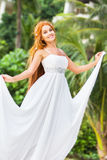 Young beautiful woman in wedding dress on natural backgro Royalty Free Stock Image