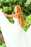 Young beautiful woman in wedding dress on natural backgro Royalty Free Stock Photography