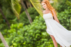 Young beautiful woman in wedding dress on natural backgro Royalty Free Stock Photos