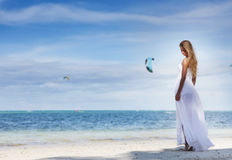 Young beautiful woman in wedding dress on tropical beach royalty free stock images
