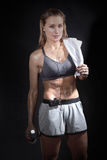 Young beautiful woman wet with sweat. After a tough workout royalty free stock image