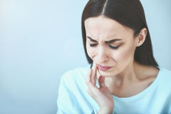 Young beautiful woman which suffering from toothache. royalty free stock image