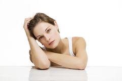 Young beautiful woman with white backround. Looking relaxed Royalty Free Stock Images