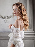 Young beautiful woman in a white baroque dress Stock Photos