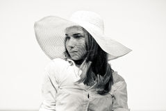 Young beautiful woman in white beach hat portrait Stock Photo