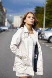 Young beautiful woman in white coat Stock Photography