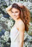 Young beautiful woman in white dress Stock Photo