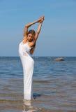 Young beautiful woman. In white dress enjoyingsummer time Royalty Free Stock Photography