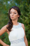 Young woman in white dress on nature Royalty Free Stock Images