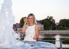 Young beautiful woman in a white dress near the fountain Royalty Free Stock Photography
