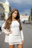 Young beautiful woman in white dress Royalty Free Stock Image