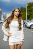 Young beautiful woman in white dress Royalty Free Stock Photography
