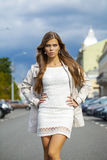 Young beautiful woman in white dress Royalty Free Stock Photo