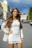 Young beautiful woman in white dress Royalty Free Stock Images