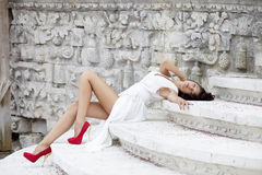 Young beautiful woman in white dress Stock Images