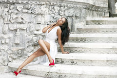Young beautiful woman in white dress Royalty Free Stock Photos