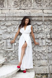 Young beautiful woman in white dress Stock Photos