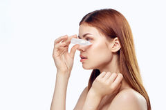 Young beautiful woman on white isolated background burying her eyes, portrait, space for copy stock photo