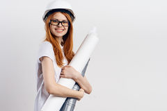 Young beautiful woman on white isolated background holds blueprints, designer, engineer Stock Photo