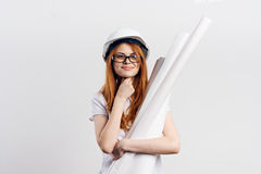 Young beautiful woman on white isolated background holds blueprints, engineer Royalty Free Stock Photos