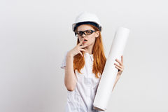 Young beautiful woman on white isolated background holds blueprints, engineer, designer Stock Images