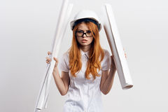 Young beautiful woman on white isolated background holds blueprints, engineer, designer Royalty Free Stock Images