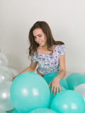 Young beautiful woman in white shorts and colorful top playing with balloons , slow motion Royalty Free Stock Photography