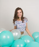 Young beautiful woman in white shorts and colorful top playing with balloons , slow motion Stock Image
