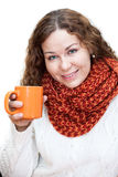 Young beautiful woman in white sweater with cup in hand Stock Photos