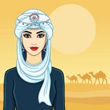 The young beautiful woman in a white turban and silver jewelry. Royalty Free Stock Photography