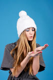 Young beautiful woman in white winter hat Royalty Free Stock Photography