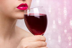 Young beautiful woman with wine Stock Images