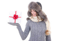 Young beautiful woman in winter clothes with christmas present i Stock Image