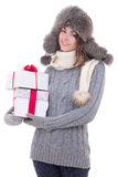 Young beautiful woman in winter clothes with christmas presents Stock Images