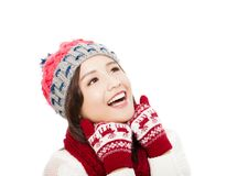 Young beautiful woman in winter clothes and looking up Royalty Free Stock Images