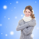Young beautiful woman in winter clothes over snow christmas back Stock Images