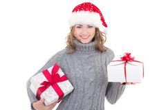 Young beautiful woman in winter clothes and santa hat with chris Royalty Free Stock Photo