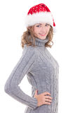 Young beautiful woman in winter clothes and santa hat isolated o Royalty Free Stock Image