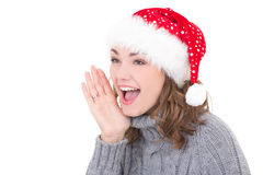 Young beautiful woman in winter clothes and santa hat screaming Stock Photography