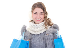 Young beautiful woman in winter clothes with shopping bags isola Stock Photo