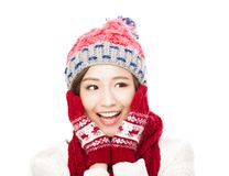 Young beautiful woman in winter clothes and touching face Stock Images