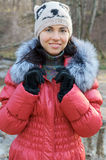 Young beautiful woman in winter overclothes Royalty Free Stock Images