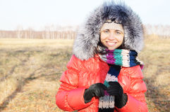 Young beautiful woman in winter overclothes Stock Photo