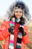 Young beautiful woman in winter overclothes Royalty Free Stock Image