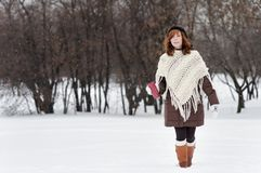 Young beautiful woman in winter park Royalty Free Stock Photography