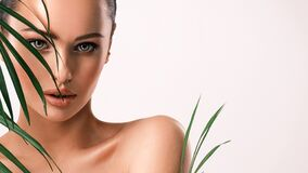 Free Young Beautiful Woman With Green Leaves Near Naked Body. Body Care Beauty Treatments Concept.  Girl`s  Face With Green Flowers Stock Image - 203557601