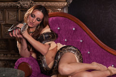 Free Young Beautiful Woman With Snake. Royalty Free Stock Photos - 23024568
